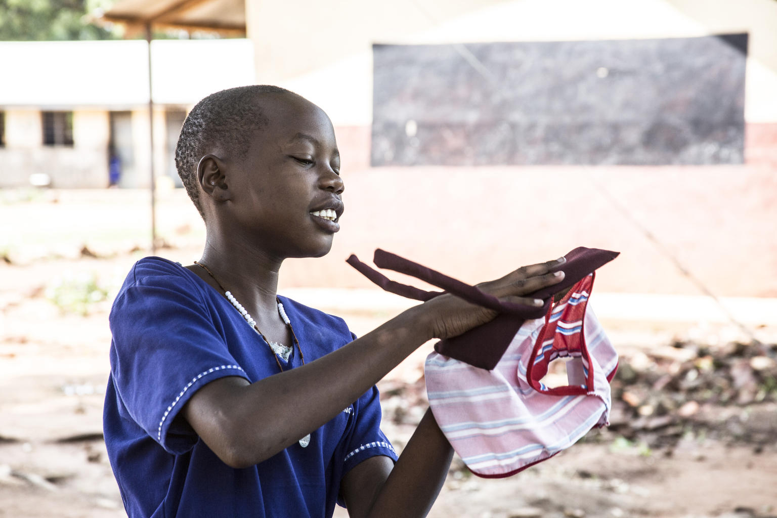 © UNICEF/Adriko - A member of the school club at Morulem Primary School in Abim District, demonstrates to her peers how reusable pads are used.